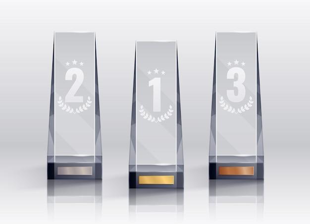 Realistyczny zestaw trofeów z odizolowanymi symbolami pierwszego drugiego i trzeciego miejsca