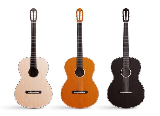 Realistyczny zestaw trzech klasycznych drewnianych gitar akustycznych z nylonowymi strunami na białym tle