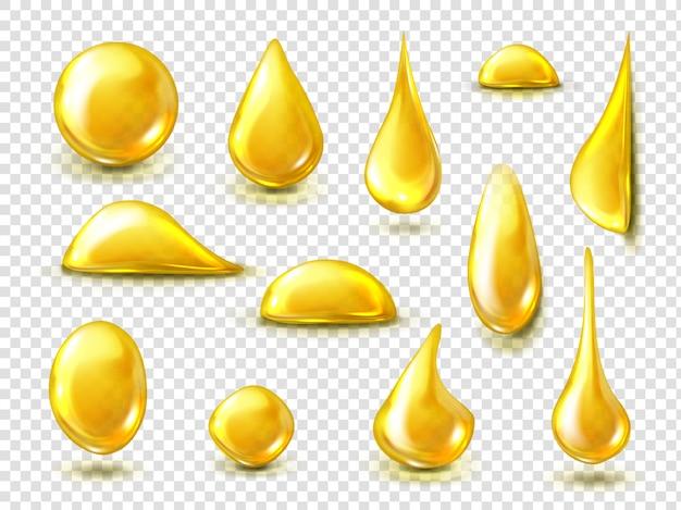 Realistyczny zestaw złotych kropli oleju lub miodu