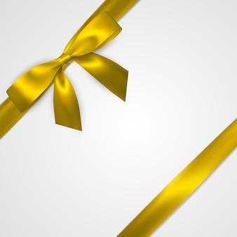 Realistyczny złoty łuk z żółtymi wstążkami na białym tle