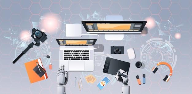 Ręce robota fotograf w miejscu pracy projektant robotów