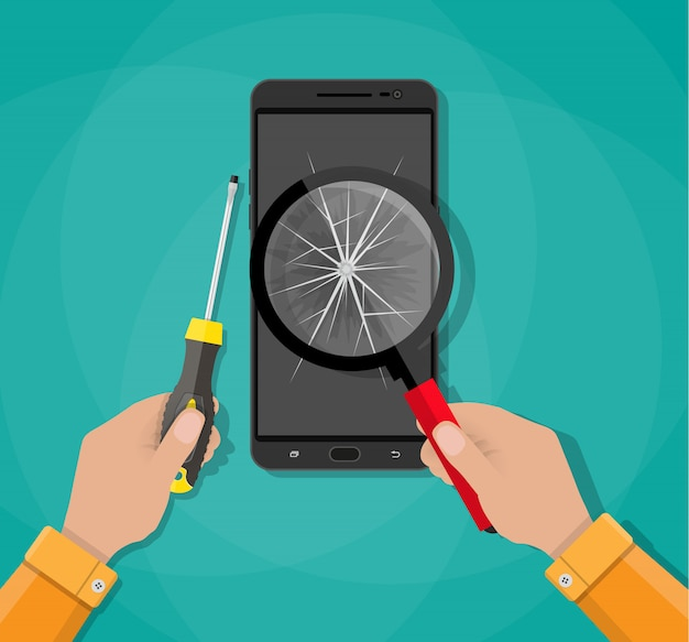 Ręce, telefon z uszkodzonym ekranem, śrubokręt