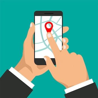 Ręce trzyma smartfon z nawigacją po mapie na ekranie. nawigator gps z czerwoną końcówką. mapa miasta ze znacznikami punktów.