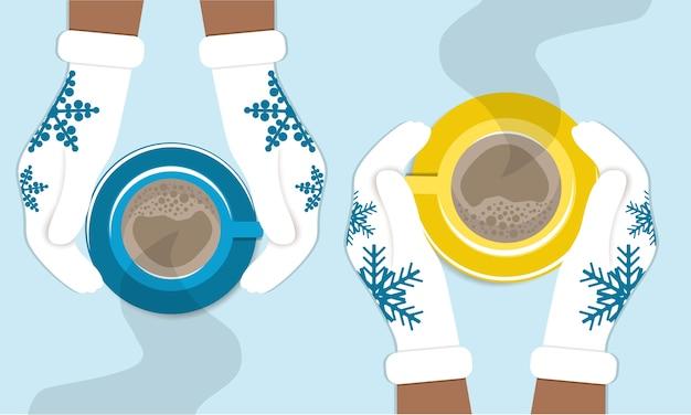 Ręce trzymają filiżanki kawy w dzianinowych rękawiczkach zimowych. zimowa przytulna ilustracja dwóch przyjaciół pijących kawę, cappuccino.