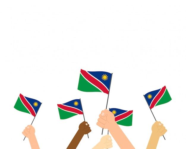 Ręce, trzymając flagi namibii