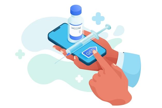 Ręce trzymające smartfon z butelką szczepionki i strzykawką na ekranie