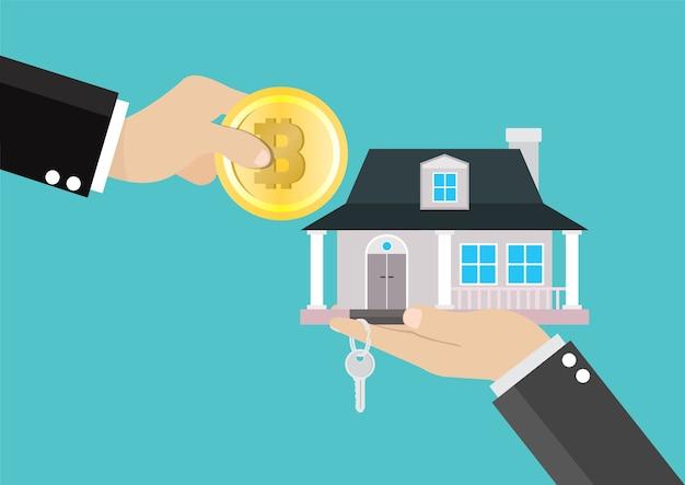 Ręce wymieniające bitcoiny na dom.