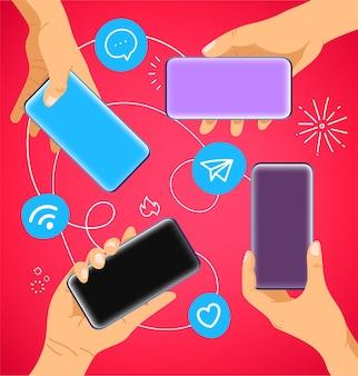 Ręce z nowoczesnymi smartfonami