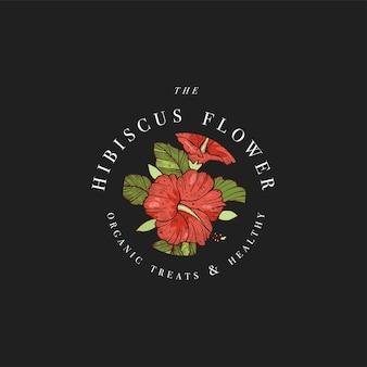 Ręcznie rysować ilustracja logo kwiaty hibiskusa. wieniec kwiatowy. botaniczny kwiatowy emblemat z typografią na czarnym tle.