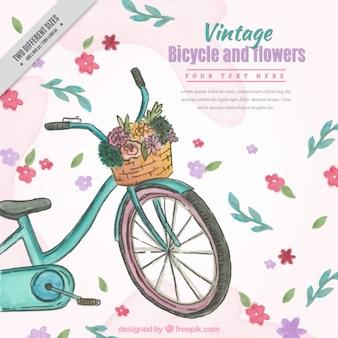 Ręcznie rysowane akwarele rocznika rower z kwiatami w tle