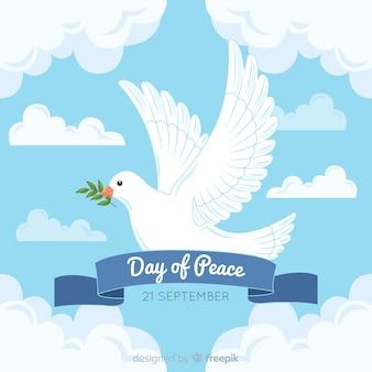 Ręcznie rysowane dzień pokoju z gołębicą i wstążką