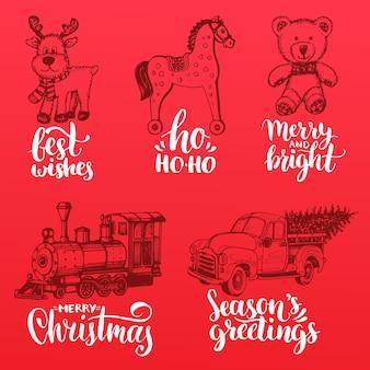 Ręcznie rysowane ilustracje zabawek świątecznych. napis do narodzenia