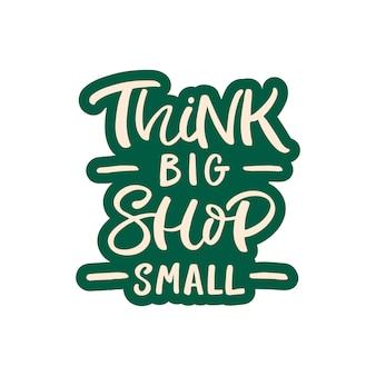 Ręcznie rysowane karty z napisem. napis: think big shop small.