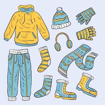 Ręcznie rysowane kolekcja zimowych ubrań i niezbędnych artykułów