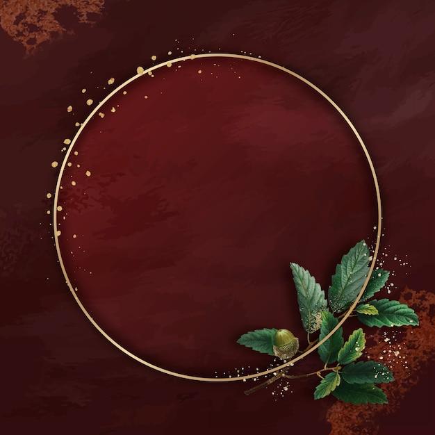 Ręcznie rysowane liść dębu z okrągłą złotą ramą na czerwonym tle