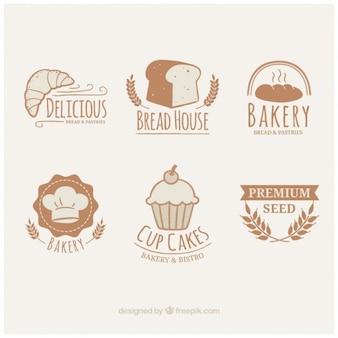 Ręcznie rysowane logotypy słodkie pieczywo