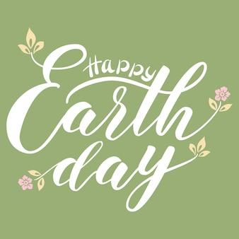 Ręcznie rysowane napis szczęśliwy dzień ziemi.