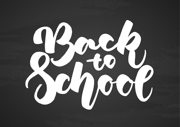 Ręcznie rysowane napis z powrotem do szkoły na tle tablica