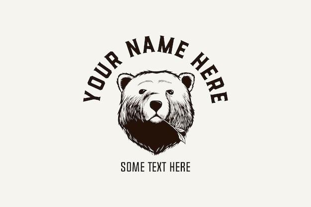 Ręcznie rysowane niedźwiedź z szablonem logo premium liść