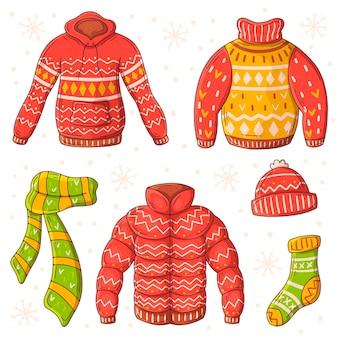 Ręcznie rysowane pakiet zimowych ubrań i niezbędnych rzeczy