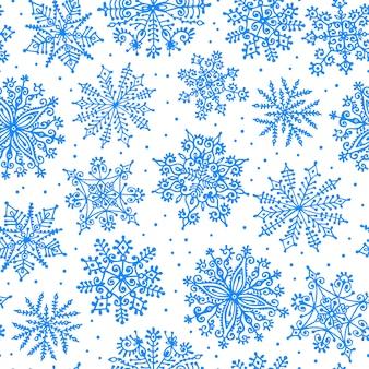 Ręcznie rysowane płatki śniegu. wzór.