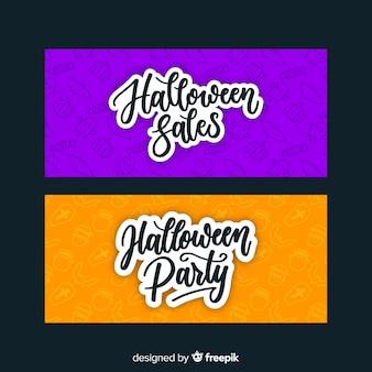 Ręcznie rysowane pomarańczowe i fioletowe banery halloween