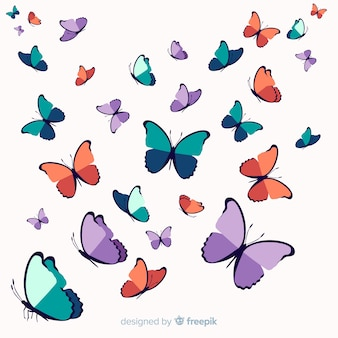 Ręcznie rysowane rój motyl tło