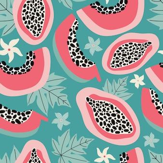 Ręcznie rysowane różowy papaja wzór na turkusowym tle. egzotyczne letnie owoce przecięte na pół miąższem, nasionami, liśćmi i kwiatami. nowoczesny design tekstyliów, tkanin, opakowań. mieszkanie