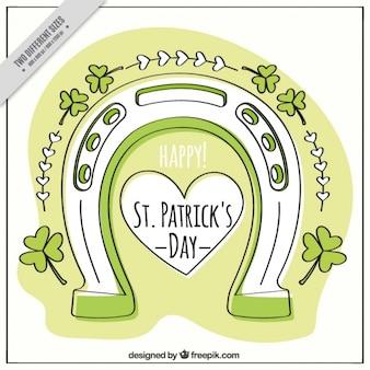 Ręcznie rysowane saint patrick dzień podkowy tle