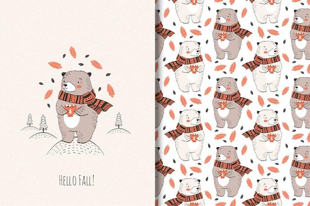 Ręcznie rysowane słodki miś z kubkiem. ilustracja zwierząt jesienią.