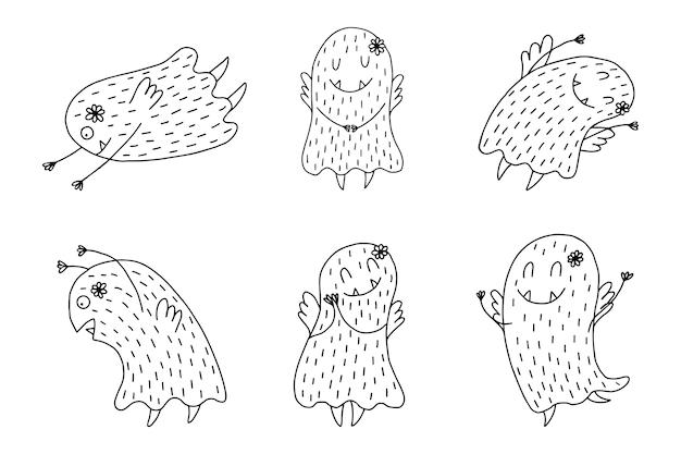 Ręcznie rysowane słodkie potwory na białym tle.
