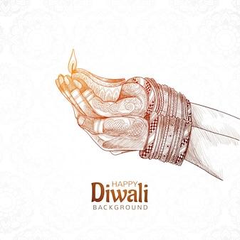 Ręcznie rysowane szkic dłoni trzymającej tło festiwalu diwali indyjskiej lampy naftowej