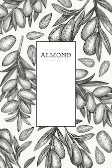 Ręcznie rysowane szkic szablon projektu migdałów. ilustracja wektorowa żywności ekologicznej. ilustracja retro nakrętki. tło botaniczne w stylu grawerowanym.
