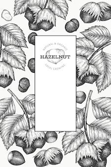 Ręcznie rysowane szkic szablonu orzecha laskowego. ilustracja żywności ekologicznej na białym tle. ilustracja rocznika nakrętki. tło botaniczne w stylu grawerowanym.