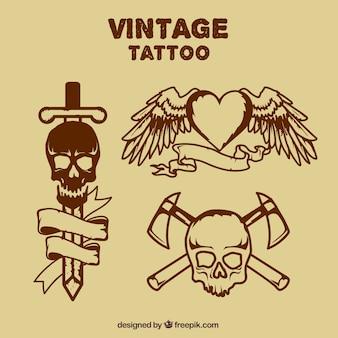 Ręcznie rysowane tatuaże czaszki i serca ze skrzydłami