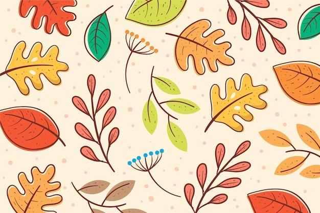 Ręcznie rysowane tła jesienne liście