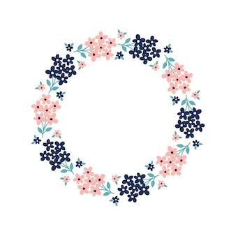 Ręcznie rysowane wieniec z różowymi i ciemnoniebieskimi kwiatami z białym tłem
