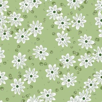 Ręcznie rysowane wiosna wzór z losowymi kształtami białych kwiatów. pastelowe zielone tło z bąbelkami. płaski nadruk wektorowy na tekstylia, tkaniny, opakowania na prezenty, tapety. niekończąca się ilustracja.