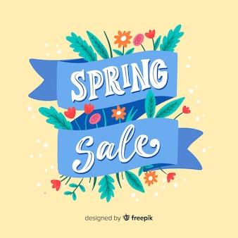 Ręcznie rysowane wstążka wiosna sprzedaż tło