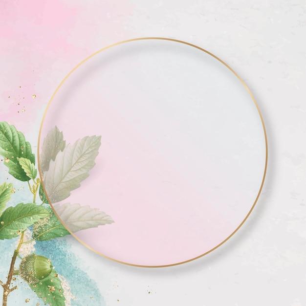 Ręcznie rysowane wzór liścia dębu z okrągłą złotą ramą na różowym tle wektora