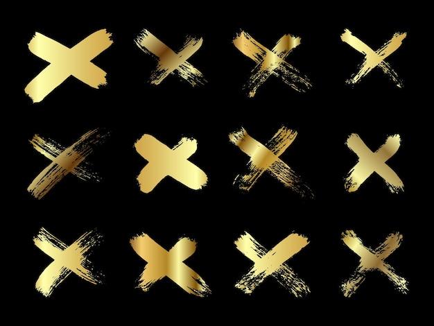 Ręcznie rysowane zestaw krzyżowych pociągnięć pędzlem x kolekcja złotych pasków krzyż znak graficzny symbol wektor