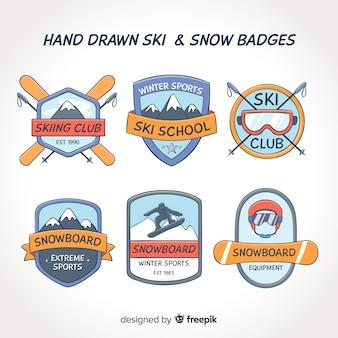 Ręcznie rysowane zestaw odznaki narciarskie i śnieg