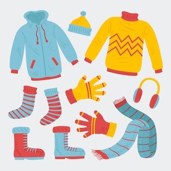 Ręcznie rysowane zestaw zimowych ubrań i niezbędnych rzeczy