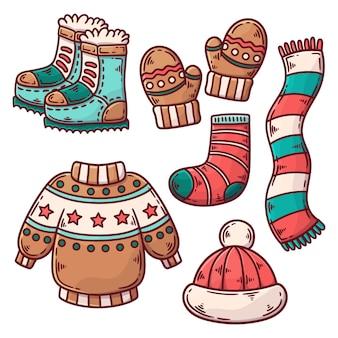 Ręcznie rysowane zimowe ubrania i kolekcja niezbędnych artykułów