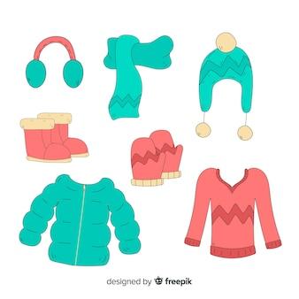 Ręcznie rysowane zimowe ubrania i niezbędne akcesoria