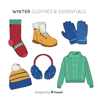 Ręcznie rysowane zimowe ubrania i niezbędne rzeczy