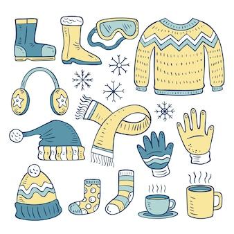 Ręcznie rysowane zimowe ubrania i niezbędny zestaw
