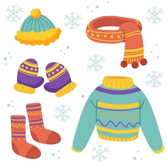Ręcznie rysowane zimowe ubrania i zestaw niezbędnych akcesoriów