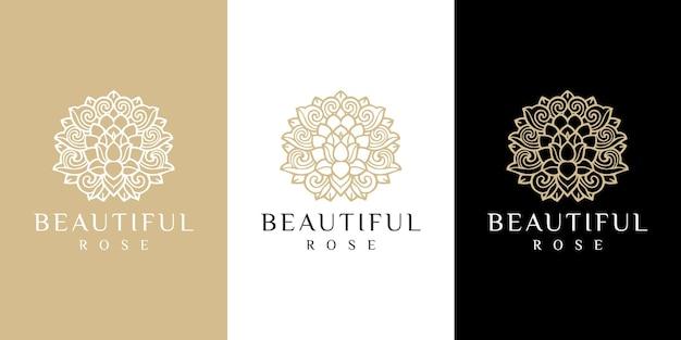Ręcznie rysowane złote kobiece piękno i kwiatowe logo botaniczne
