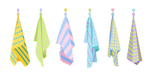 Ręczniki tekstylne kuchenne. kreskówka wiszący ładny zestaw ręczników z tkaniny, ilustracji wektorowych suchych puszystych przedmiotów do czyszczenia na białym tle